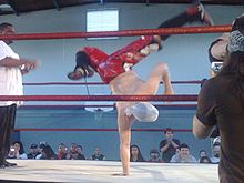 Sports Photos - Jack Evans (Jack Miller) - Evans breakdancing in the ring.