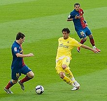 Soccer Photos - Daniel Alves - Dani Alves (right) and Lionel Messi in a match against Villarreal.
