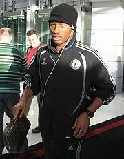 Soccer Photos - Didier Drogba  - Drogba out on tour with Chelsea in 2007