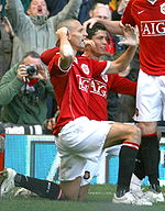 Soccer Photos - Cristiano Ronaldo  - Ronaldo (centre) and Rio Ferdinand celebrating a goal
