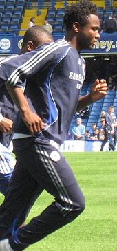 Soccer Photos - John Obi Mikel - Mikel playing for Chelsea against Fulham on 28 December 2009
