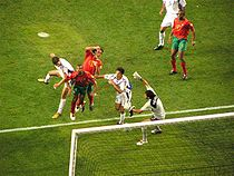 Soccer Photos - Angelos Charisteas - Charisteas scoring the winning goal against Portugal in the Euro 2004 final.