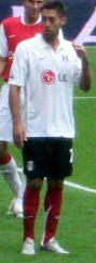 Soccer Photos - Clint Dempsey - Dempsey playing for Fulham in 2007.