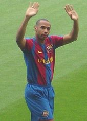 Soccer Photos - Thierry Henry  - Henry greets the Camp Nou supporters at his introduction.