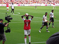 Soccer Photos - Abou Diaby - Diaby taking a throw-in against Fulham during the 2006