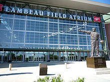 Football Photos - Curly Lambeau - A statue of Curly Lambeau stands near the main entrance to Lambeau Field