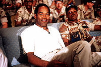 Football Photos - O.J. Simpson - Simpson in 1990 in Saudi Arabia while visiting American troops during the lead-up to the first Gulf War