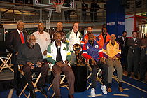 Basketball Photos - Julius Erving - Erving <b>(top left)</b> with other former NBA players visit the New York NBA Store in January 2005
