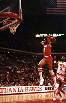 Basketball Photos - Julius Erving - Erving performing a slam dunk in 1981