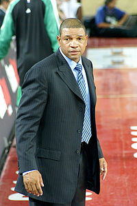 Basketball Photos - Doc Rivers - Rivers (center) sits on the sidelines with assistant coaches Tom Thibodeau (right) and Armond Hill (left) in Game 4 of the 2008 NBA Playoffs against the Atlanta Hawks.