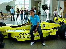 Motorsports Photos - Graham Rahal - Rahal posing with a show car when he raced in Champ Car in 2007
