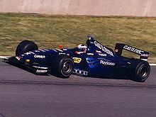 Motorsports Photos - Jarno Trulli - Trulli driving for Prost at the 1999 Canadian Grand Prix.