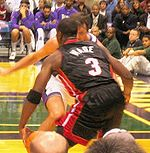 Basketball Photos - Dwyane Wade - Wade with the ball versus the Milwaukee Bucks in 2005