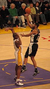 Basketball Photos - Andrew Bynum - Bynum defending Tim Duncan