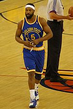 Basketball Photos - Baron Davis - Davis in the Warriors throwback uniform