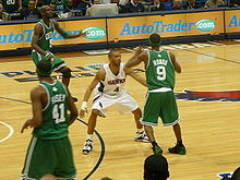 Basketball Photos - Acie Law Iv - Law guards Rajon Rondo of the Boston Celtics in the 2008 NBA Playoffs.