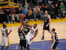 Basketball Photos - Bruce Bowen - Bowen (no. 12) contesting a layup in a game against the Los Angeles Lakers