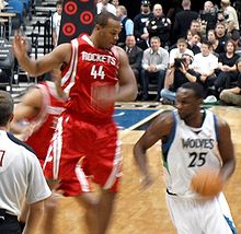 Basketball Photos - Al Jefferson - Jefferson driving against Chuck Hayes of the Houston Rockets.