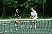 Tennis Photos - Chris Evert - George Bush and Chris Evert playing tennis at Camp David