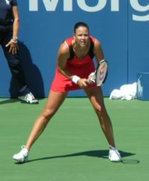 Tennis Photos - Lindsay Davenport - Davenport preparing to return serve at the 2006 U.S. Open against Katarina Srebotnik of Slovenia in the third round on the Grandstand court