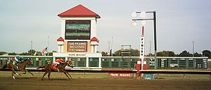 Horse Racing Photos - Prairie Meadows - Horses are about to cross the finish line during a September 5