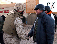 Football Photos - Jim Mcmahon - McMahon being greeted by the Commanding Officer of the 15th MEU during his USO tour in Iraq in December 2006.