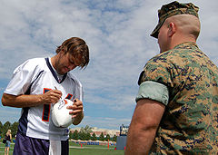 Football Photos - Jake Plummer - Plummer signs a football at Broncos training camp in 2006