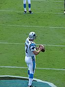 Football Photos - Jake Delhomme  - Delhomme taking warmups before a game against the Chicago Bears on September 14