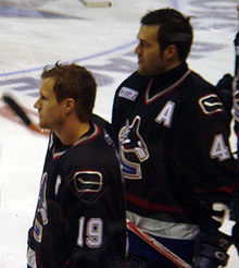 Hockey Photos - Markus Naslund - Näslund and Todd Bertuzzi (right) were joined by Brendan Morrison to form the West Coast Express.