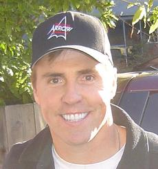 Football Photos - Bill Romanowski Photos