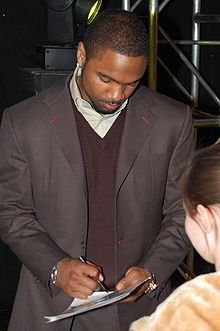 Football Photos - Charles Woodson - Woodson signing autographs in March 2008
