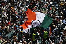 Sports Photos - India Cricket Team - Supporters of the Indian cricket team wave the Indian flag during match between India and Australia at the Melbourne Cricket Ground.