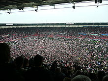 Soccer Photos - Stoke City F.C. - Stoke City fans celebrate following promotion to the Premier League