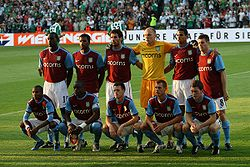Soccer Photos - Aston Villa F.C. - The Aston Villa starting line-up prior to a UEFA Europa League match away at Rapid Vienna in August 2009. (Top