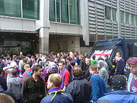 Soccer Photos - Crystal Palace F.C. - Crystal Palace fans protest - and await anxiously for news - outside the Lloyds HQ in London on 1 June 2010