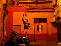 Soccer Photos - A.S. Roma - A mural of Francesco Totti painted after Roma's 2000