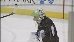 Hockey Photos - Marc-Andre Fleury - Marc-Andre Fleury donning Kermit the Frog mask during practice in October 2009.