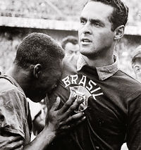 Soccer Photos - Pele - Pelé cries on the shoulder of a peaceful Gilmar, after Brazil win the 1958 Cup.