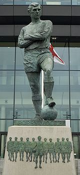 Soccer Photos - Bobby Moore - A statue of Moore outside Wembley Stadium.