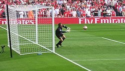 Soccer Photos - Jens Lehmann - Lehmann diving to save a shot during a warm-up.