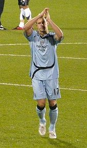 Soccer Photos - Alan Smith - Smith applauding Newcastle supporters.