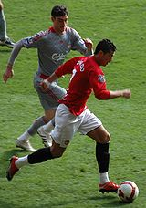 Soccer Photos - Cristiano Ronaldo - Ronaldo and Manchester United against Albert Riera and rivals Liverpool.