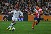 Soccer Photos - Cristiano Ronaldo - Ronaldo and Real Madrid against Diego Forlán and city rivals Atlético Madrid.