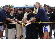 College Basketball Photos - Ruth Riley - Riley at the ribbon cutting for four donated basketball courts in Angola