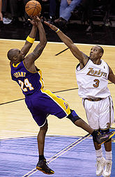 College Basketball Photos - Caron Butler - Butler defends former teammate Kobe Bryant