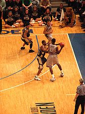 College Basketball Photos - Jeff Green - Jeff Green passes to teammate Jonathan Wallace during the finals of the 2007 Big East Men's Basketball Tournament.