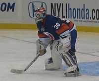 Hockey Photos - Dwayne Roloson - Roloson in goal for the New York Islanders during their season home-opener.