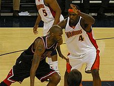 College Basketball Photos - Joe Smith - Smith (left) driving against the Warriors' Chris Webber (#4) with the Bulls in 2008