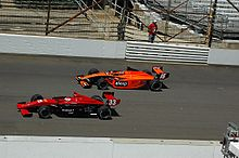 Motorsports Photos - Wade Cunningham - Cunningham (inside) racing in Indy Lights in 2008
