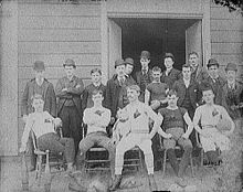 Football Photos - American Football - An American football team at the turn of the 20th century. Note the continued use of a rugby-type ball (front row